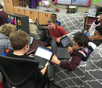 Students collaborate together in small groups while working on their Cal Water H2O project