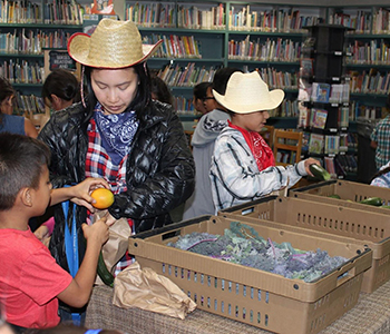 2nd grade students participating in a Farmer's Market at the library